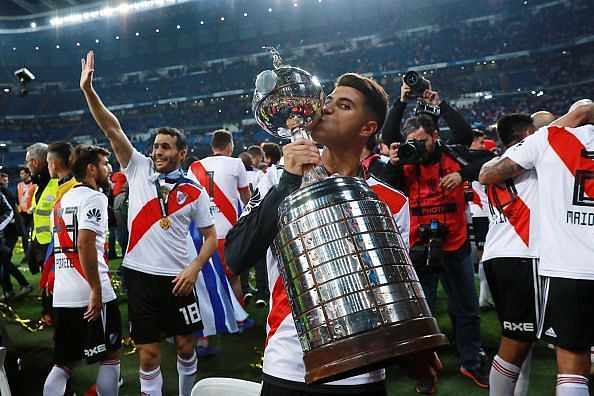 Real Madrid transfer target Exequiel Palacios with the trophy
