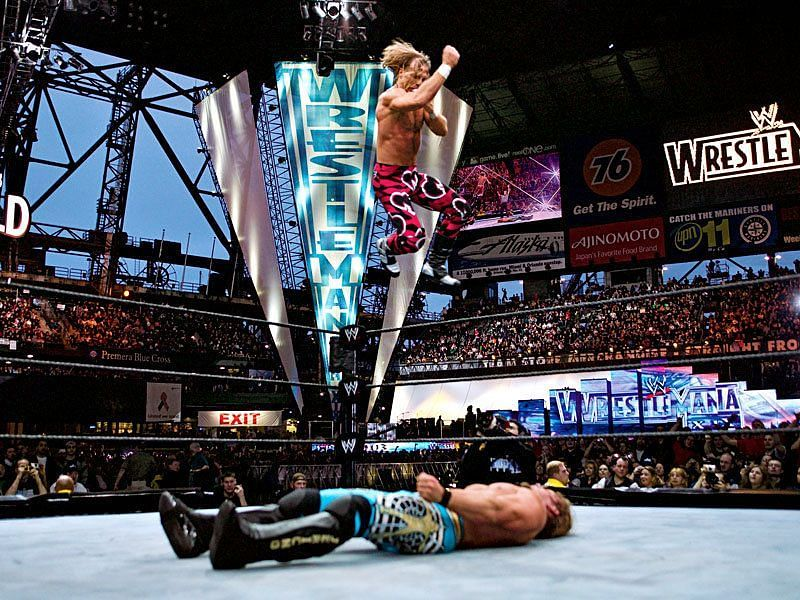 HBK in mid-air performing his signature elbow drop!
