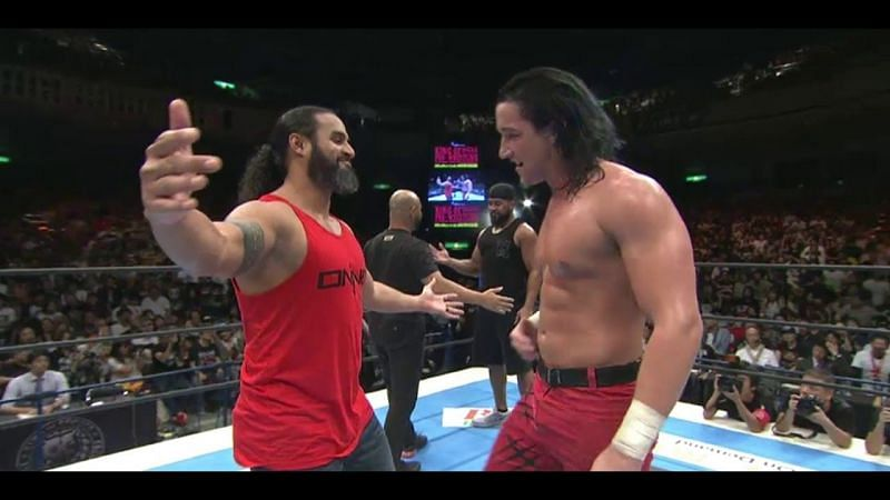 Tonga and White embrace after demolishing Okada in the middle of the ring.