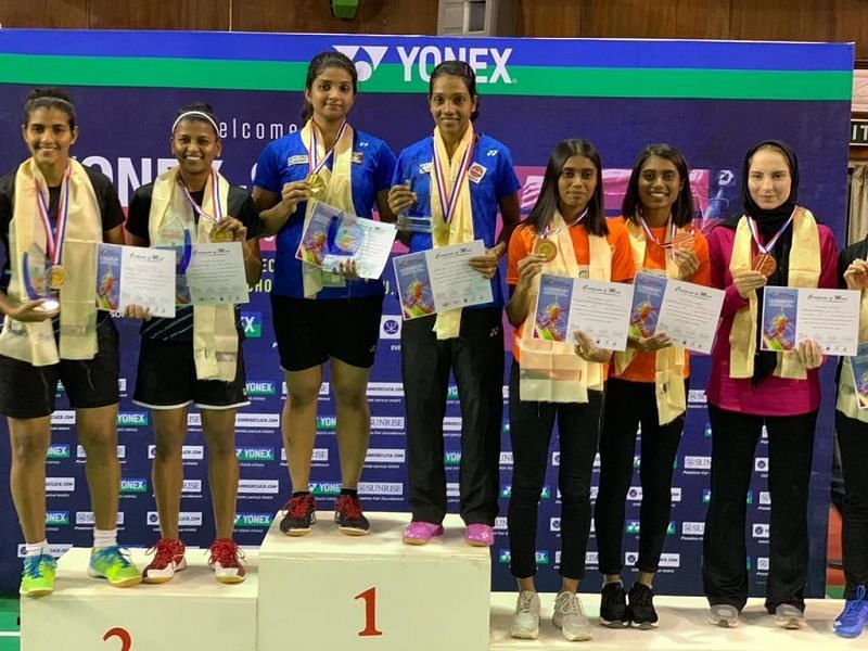 Sruthi KP and Aparna Balan on the top podium with their medals (image courtesy: Aparna Balan Twitter)