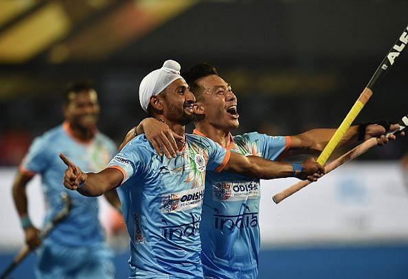 Indian players celebrate after scoring a goal against South Africa
