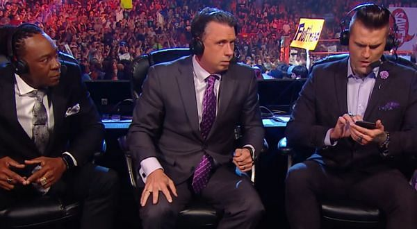 Booker T, Michael Cole and Corey Graves.