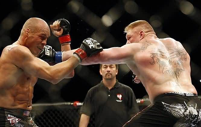 Brock Lesnar smashes the champion with a big time left hand