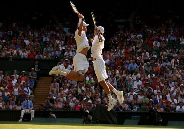 The Bryans with their signature chest bump celebrations after winning the The Championships - Wimbledon 2013
