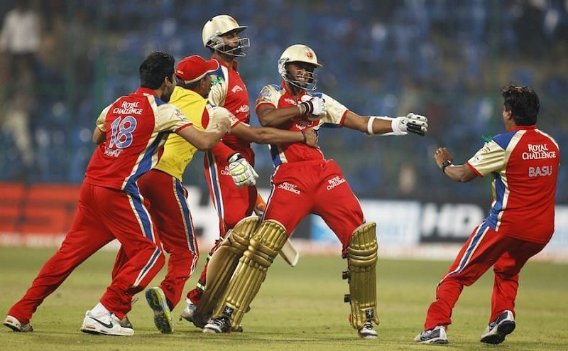 KB Arun Karthik (second from right) celebrates after his last-ball six