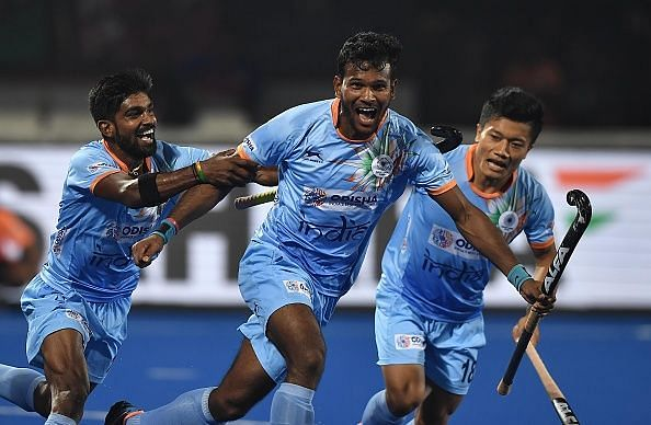 Indian players celebrating after scoring against Canada