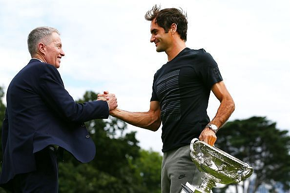 Federer holds the Norman Brookes Challenge Cup 2018 - the trophy awarded to the winner of the Australian Open