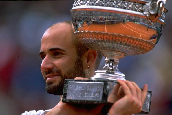 Andre Agassi with the 1999 French Open trophy
