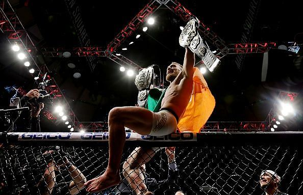 Conor McGregor becomes the first dual champion in UFC history at UFC 205