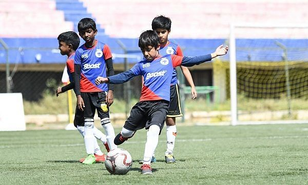 Action from the Boost-BFC Inter-School Soccer Shield Day 2