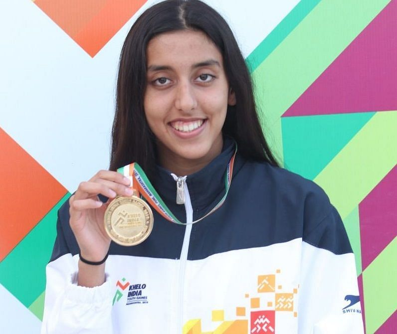 Kenisha Gupta from Maharashtra with her 50m freestyle gold medal in swimming