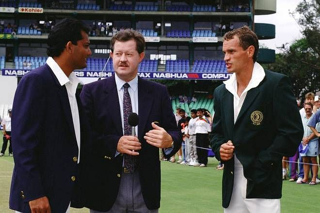 Indian skipper Azharuddin and South African skipper Kepler Wessels with an official