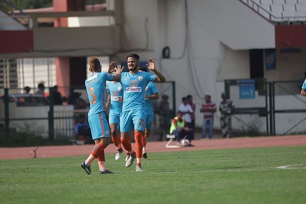Indian Arrows players celebrate after scoring against Minerva Punjab during their I-League match at the Kalinga Stadium in Bhubaneswar