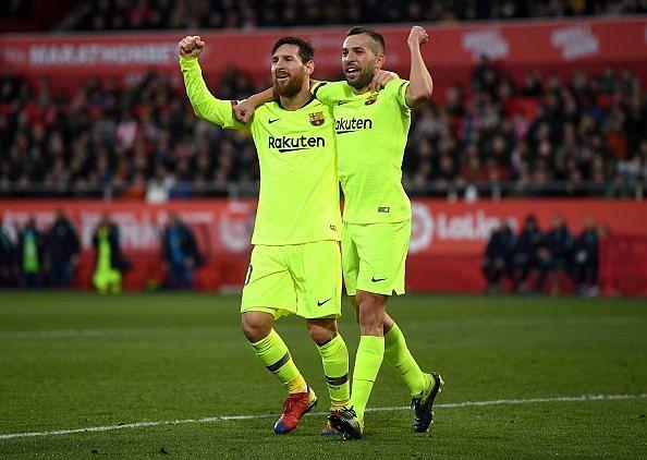 Lionel Messi and Jordi Alba