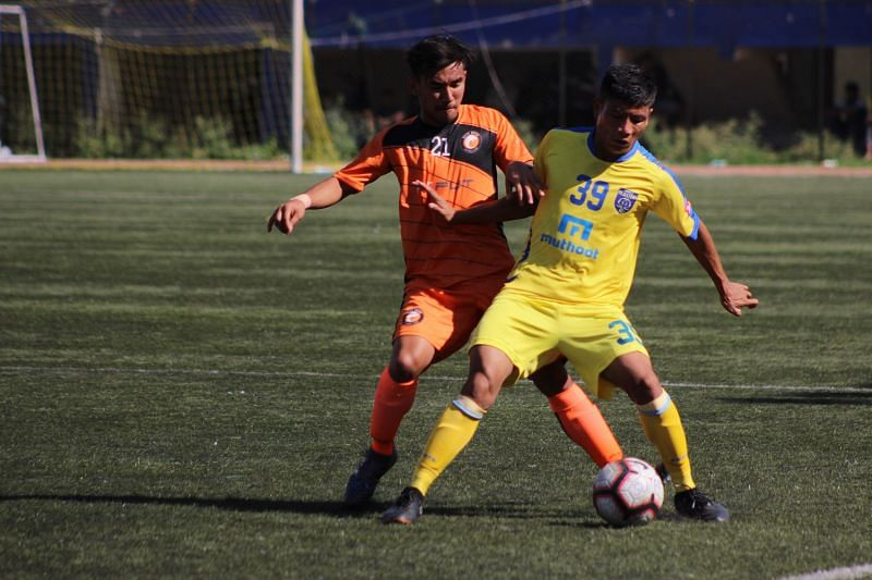 Kishan of South United FC battles for the ball
