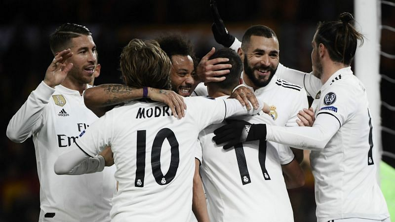 Real Madrid players celebrate a goal vs AS Roma in a UEFA Champions League group stage match