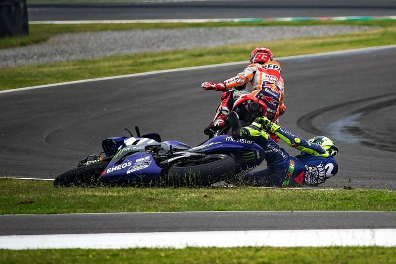 Rossi crashing after collision with Marc Marquez