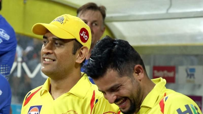 Dhoni and Raina sharing a lighter moment