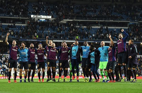 The Blaugrana celebrate their win with a gesture to the away supporters.