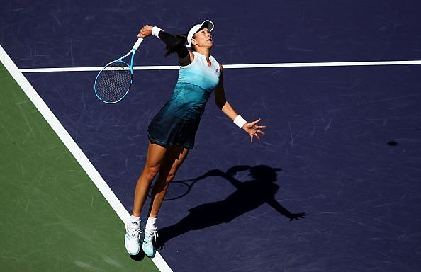 Garbine Muguruza jumps big on the serve during her match with Kiki Bertens at the BNP Paribas Open