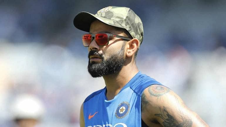 Virat kholi with Indian Army cap