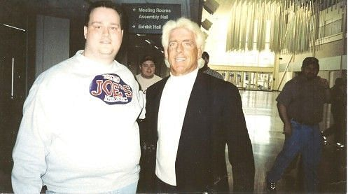 Ric Flair with a happy fan during his WCW days.