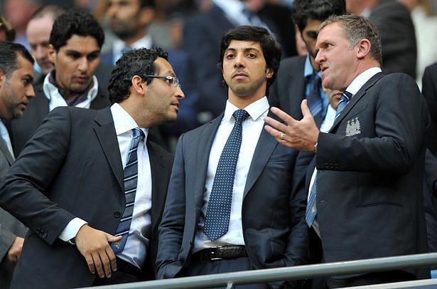 Owner SheikMansour (centre) with chairman Khaldoon Al Mubarak (Left)