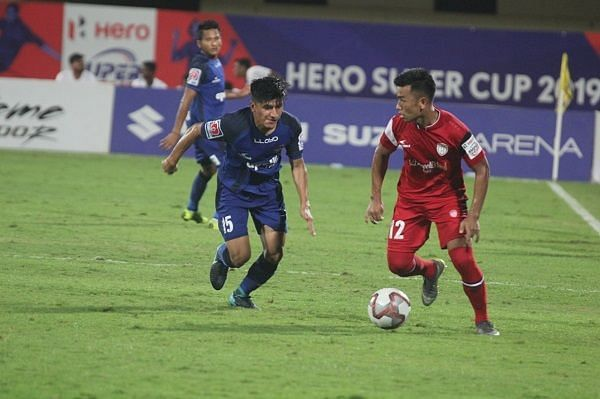 Anirudh Thapa of Chennaiyin FC in a tussle for possession with Reagan Singh of NorthEast United during their Super Cup match