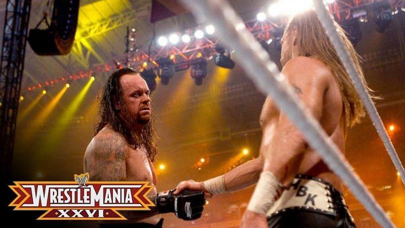Undertaker shaking Shawn