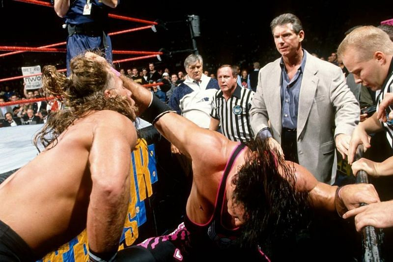 Bret Hart brawls with Shawn Michaels as Vince McMahon looks on at the 1997 Survivor Series