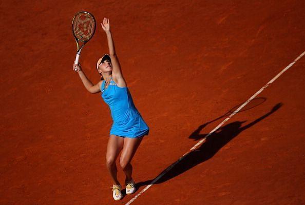 Belinda Bencic serving up a shot to Svetlana Kuznetsova at the Mutua Madrid Open