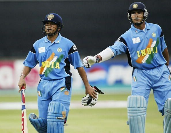 Sachin Tendulkar (left) of India is given a pat on the back by his captain