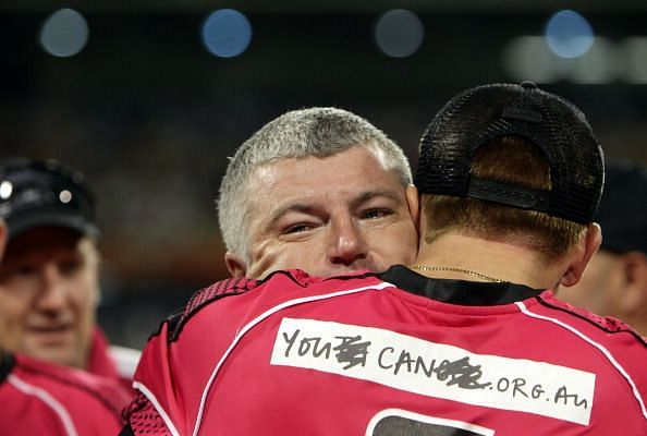 A grey-haired MacGill is hugged by Dominic Thornely after the BBL win