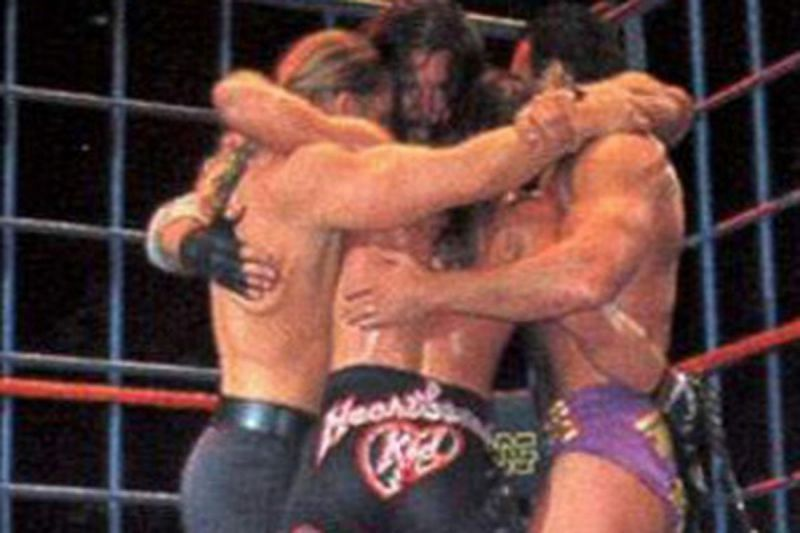 Triple H, Shawn Michaels, Kevin Nash, and Scott Hall embrace in the ring after Nash and Hall