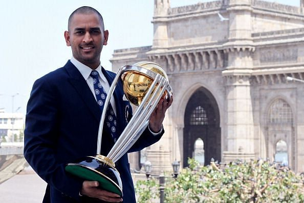 MS Dhoni with the 2011 ICC Cricket World Cup Trophy