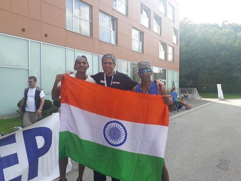 Vikash Malik with teammate Abhinav Jha and team leader Sunil Chainaini at the finish line of IAU 100k world championship