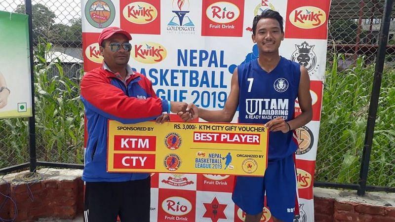 Nikesh Magar (R) of Royal Basketball Club was declared man of the match