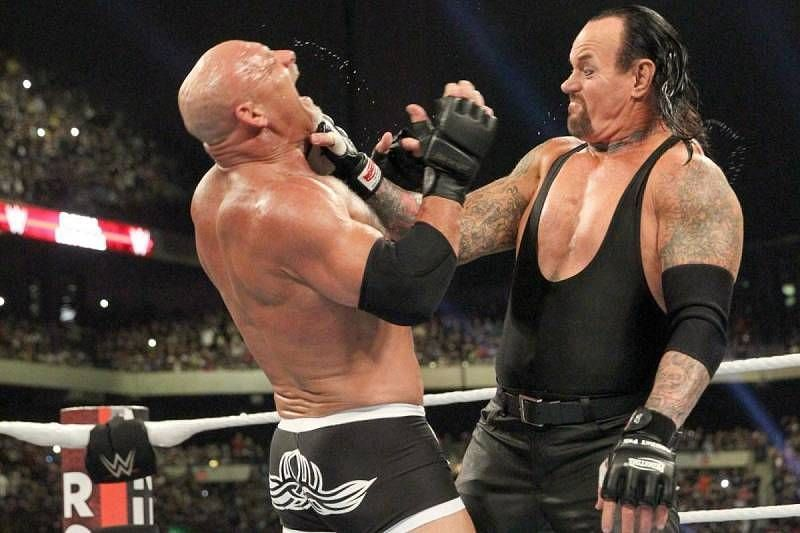 Goldberg and The Undertaker at Super ShowDown in 2019