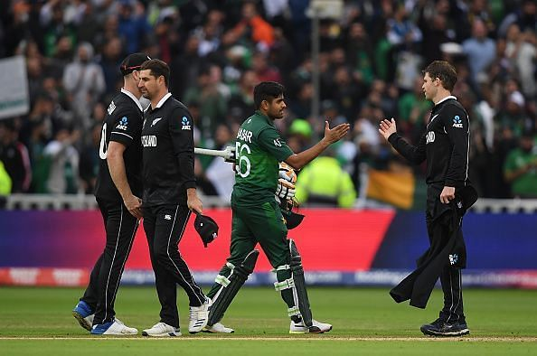 Babar Azam shaking hands with the New Zealand players after posting a comfortable win