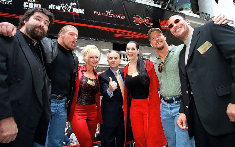 Mick Foley, Triple H, Debra, Chyna, Steve Austin, The Rock along with Richard A. Grasso (c), Chairman of the New York Stock Exchange post WWF being listed on NYSE.