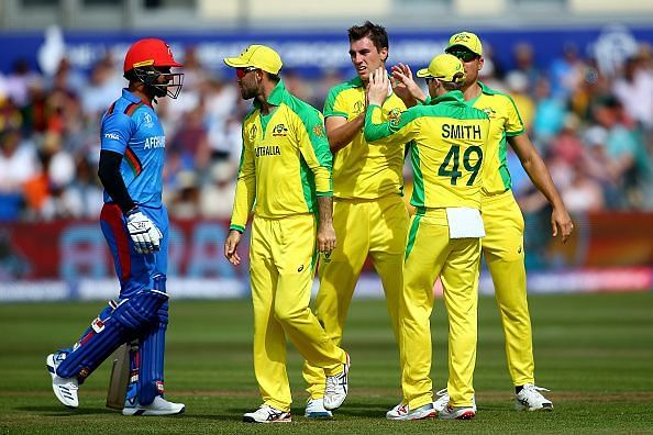 Pat Cummins celebrates the fall of an Afghanistan wicket