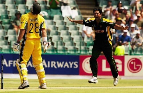 Matthew Hayden of Australia is bowled by Wasim Akram of Pakistan