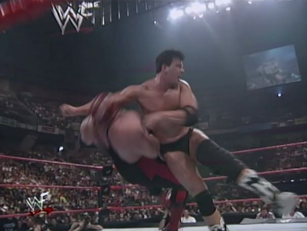 John Bradshaw Layfield, then known as Bradshaw, hits Vader with the Clothesline From Hell