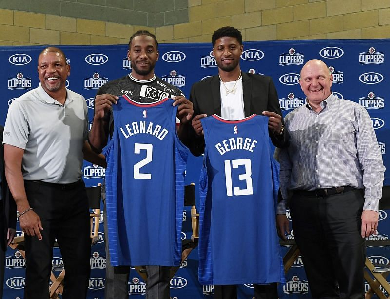 Kawhi poses for pictures alongside fellow new Clipper Paul George at their unveiling earlier this month