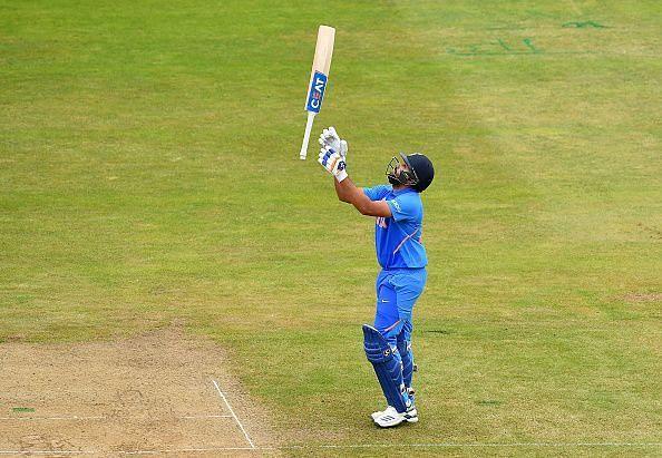 Rohit Sharma celebrates after scoring a century