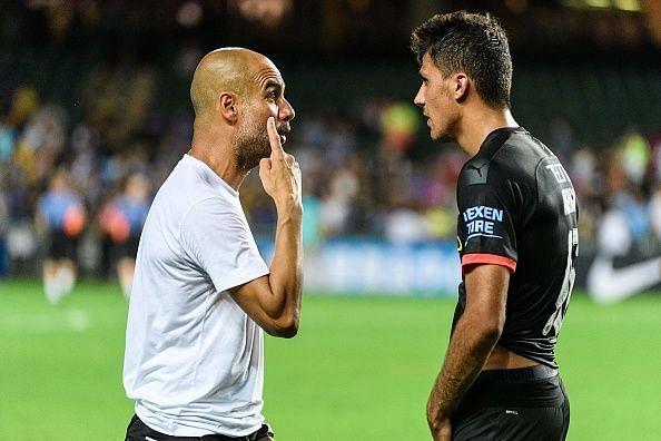 Pep Guardiola and Rodri