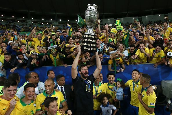 Alisson Becker with the Copa America trophy