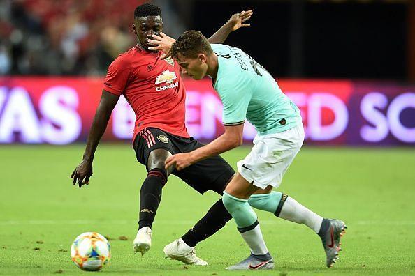 Axel Tuanzebe makes a tackle