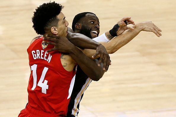 Enter Draymond Green (right) in a tussle with Danny Green