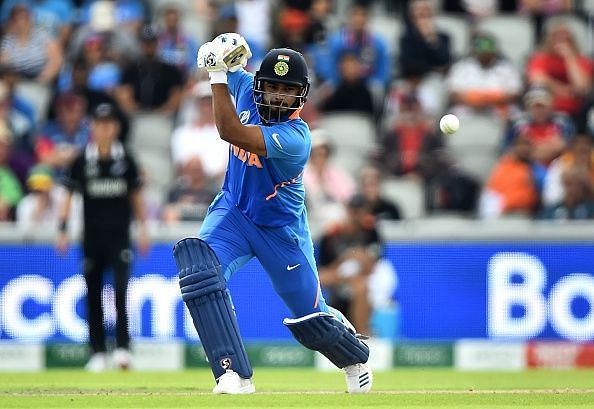 Rishabh Pant drives a ball through the covers